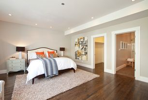 Contemporary Master Bedroom with Upholstered headboard, Hardwood floors, Anji Mountain - Silky Shag Ivory Area Rug