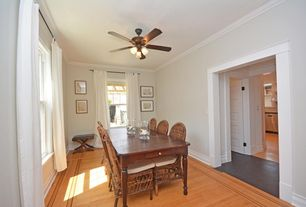 Traditional Dining Room with Standard height, Ceiling fan, Crown molding, double-hung window, Hardwood floors