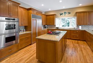 Contemporary Kitchen with Casement, can lights, full backsplash, Standard height, Complex granite counters, U-shaped, Flush