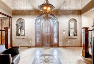 Mediterranean Entryway with specialty door, simple marble tile floors, flush light
