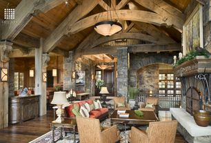 Country Great Room with stone fireplace, flush light, Pendant light, Hardwood floors, Columns, Wall sconce, Exposed beam