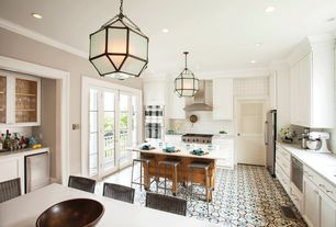 Traditional Kitchen with Crown molding, specialty door, Cavaliere - sv218f-36 wall mounted range hood, Flat panel cabinets