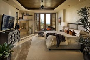 Contemporary Master Bedroom with Paint 2, simple marble floors, can lights, Paint 1, French doors, Casement, Cement fireplace