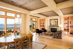 Contemporary Great Room with Pendant light, Exposed beam, French doors, Cement fireplace, High ceiling, Built-in bookshelf