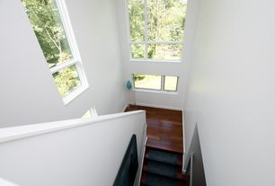 Modern Staircase with Hardwood floors, Cathedral ceiling