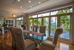 Traditional Dining Room with Transom window, Crown molding, Columns, Wall sconce, Hardwood floors