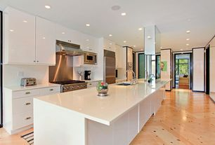 Contemporary Kitchen with Flush, One-wall, Corian counters, Standard height, flat door, full backsplash, Stainless Steel