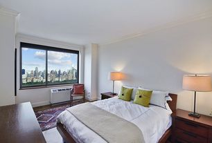 Contemporary Guest Bedroom with Hardwood floors, Crown molding