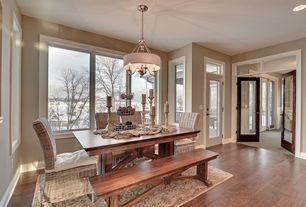 Craftsman Dining Room with WELLS EXTENDING DINING TABLE, Progress lighting 5 light drum chandelier, Hardwood floors