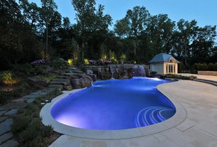 Traditional Swimming Pool with Raised beds, Fountain, Arched window, exterior stone floors, Gazebo, Pathway, French doors