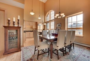 Traditional Dining Room with High ceiling, Casement, Chandelier, Hardwood floors