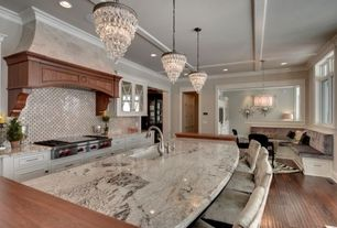 Traditional Kitchen with Crown molding, Kitchen island, Glass panel, Breakfast bar, One-wall, Custom hood, Inset cabinets