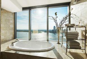 "Contemporary Master Bathroom with Daltile Baja Cream Honed Travertine, Wall sconce, Americh - Etoile 60 Tub (60"" x 22"")"