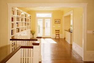 Traditional Hallway with Transom window, can lights, Crown molding, Hardwood floors, Wainscotting, Standard height