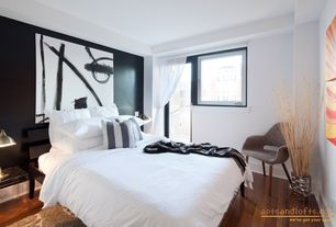 Contemporary Guest Bedroom with Laminate floors, Standard height, Casement, French doors