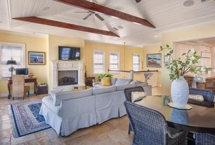 Cottage Great Room with can lights, Cement fireplace, double-hung window, Crown molding, Exposed beam, Standard height