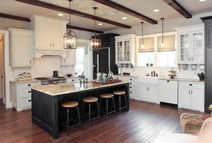 Traditional Kitchen with Breakfast bar, Complex granite counters, Exposed beam, Flat panel cabinets, European Cabinets