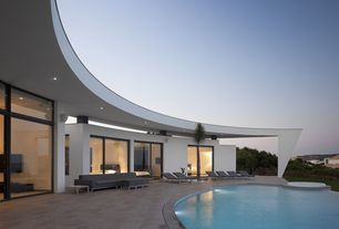 Modern Patio with Pool with hot tub, exterior stone floors, Pathway, Infinity pool, Transom window