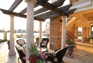 Mediterranean Patio with exterior stone floors, Trellis