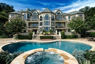 Traditional Swimming Pool with Pathway, exterior stone floors, Pool with hot tub, Arched window