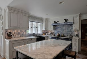 Country Kitchen with Breakfast bar, can lights, double oven range, Carrara marble countertop, Farmhouse sink, L-shaped