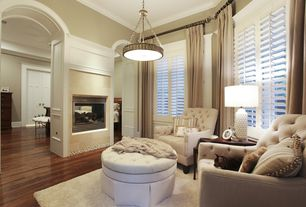 Traditional Master Bedroom with Crown molding, High ceiling, stone fireplace, Hardwood floors, Chandelier