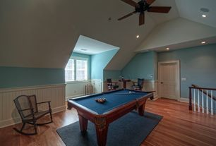 Country Game Room with can lights, Chair rail, six panel door, Ceiling fan, High ceiling, Hardwood floors, Casement