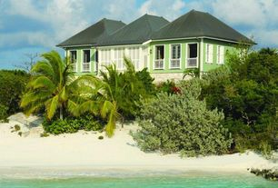 Tropical Exterior of Home with Exterior paint, Beach cottage, Water view