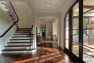 Traditional Hallway with Hardwood floors, French doors, can lights, Paint, Standard height