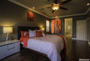Traditional Guest Bedroom with Crown molding, Ceiling fan, White interior 6-panel door, Hardwood floors