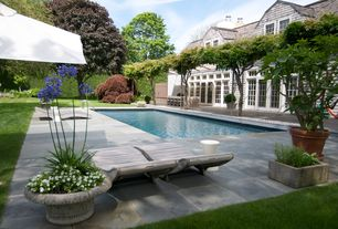Traditional Swimming Pool with French doors, Transom window, Pathway, Fence, exterior stone floors, Lap pool
