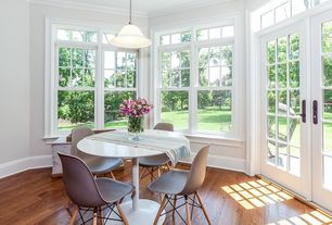 Contemporary Dining Room with French doors, Transom window, Standard height, Pendant light, Crown molding, double-hung window