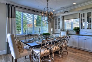 "Contemporary Dining Room with Restoration hardware foucault's orb chandelier 41"" - rustic iron, Hardwood floors, Chandelier"