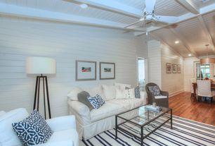 Cottage Living Room with Hardwood floors, Pb comfort roll arm sofa, Exposed beam, Ceiling fan, Tripod floor lamp