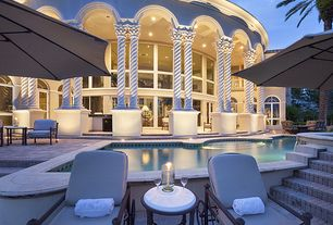Mediterranean Swimming Pool with Other Pool Type, Outdoor kitchen, picture window, exterior stone floors, French doors