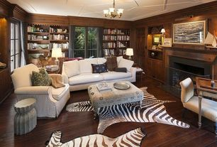 Traditional Living Room with Home creek rosedale brocade upholstered ottoman, Built-in bookshelf, Jonathan adler - zebra rug