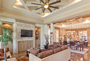 Contemporary Living Room with Ceiling fan, Crown molding, Built-in bookshelf, can lights, simple marble tile floors