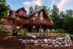 Rustic Landscape/Yard with Log home, Partial stone exterior, Rock retaining walls