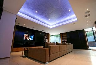 Contemporary Home Theater with sandstone tile floors, Crown molding light, High ceiling, Built-in bookshelf