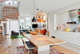 Contemporary Dining Room with Hardwood floors, can lights, Standard height, Built-in bookshelf, Columns, Pendant light