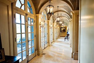 Traditional Hallway with travertine tile floors, Pendant light, Exposed beam, Cathedral ceiling, Wall sconce, Transom window