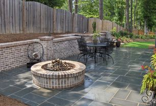 Traditional Patio with Fire pit, exterior tile floors, Pathway, Fence, Raised beds, exterior concrete tile floors