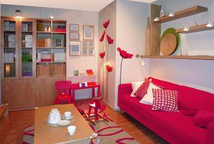 Eclectic Living Room with Hardwood floors, Built-in bookshelf, flush light