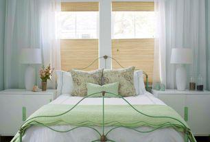 Contemporary Master Bedroom with Built-in bookshelf, Hardwood floors, specialty window, Standard height