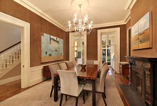 Traditional Dining Room with interior wallpaper, Hardwood floors, stone fireplace, Crown molding, specialty door, Chandelier