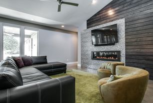 Contemporary Living Room with Concrete floors, Ceiling fan, Delta Lumber Texas Lumber Black Shou-Sugi-Ban Siding