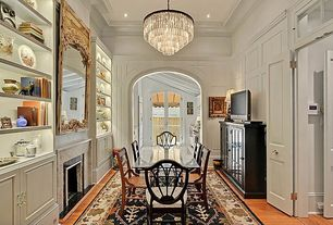 Traditional Dining Room with High ceiling, Crown molding, Hardwood floors, stone fireplace, specialty door, Chandelier
