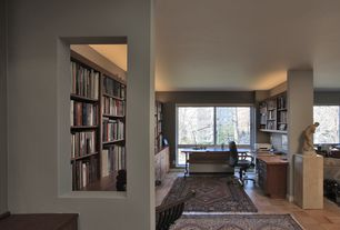 Contemporary Home Office with Built-in bookshelf, Standard height, picture window, Hardwood floors