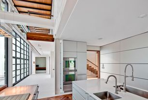 Contemporary Kitchen with L-shaped, European Cabinets, Exposed beam, Stainless trough sink, Casement, double wall oven, Flush