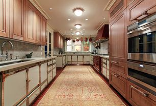 Traditional Kitchen with warming oven, Travertine counters, Custom hood, double-hung window, Galley, Flush, Standard height